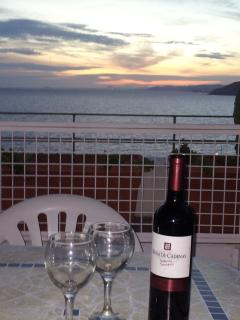 Totally chill out and sip wine on the terrace as you listen to the waves lapping over the shore.