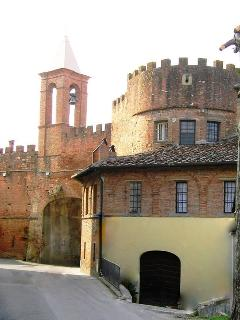 Porta Fiorentina with low polygonal tower and cuspidate bell tower