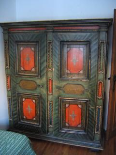 Varnished closet with typical Tyrolean painting's details