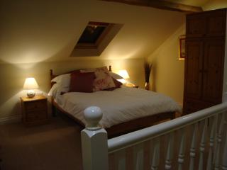 A nightime picture of our gorgeous galleried bedroom, wonderfully cosy and romantic.