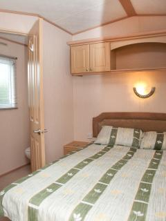 Main bedroom leading to ensuite to the left of the picture