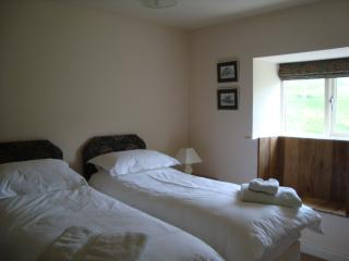 Our groundfloor bedroom with kingsize bed unzips to 2 singles, lovely window seat to view birds