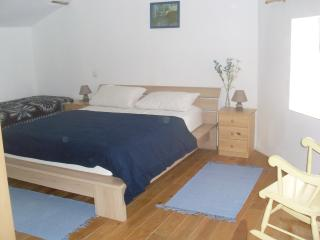 main bedroom with one double bed and one single bed