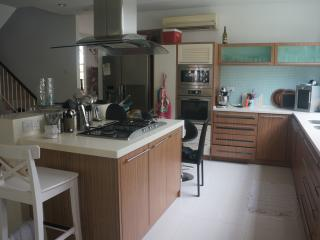 Fully fitted kitchen area with bar stools and breakfast bar. Microwave oven and dishwasher