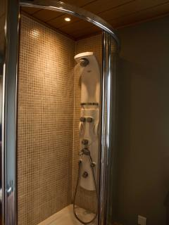 Luxurious power shower with complimentary toiletries...