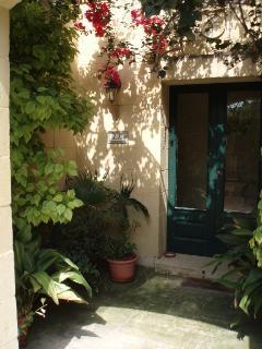 courtyard and front door of villa