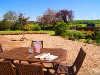 Enjoy lazy Summer days on the patio overlooking the walled garden.