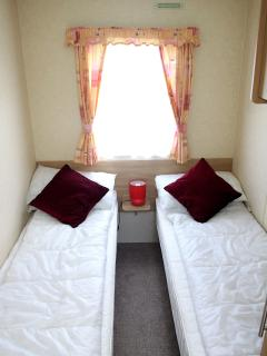 one of our twin bedded rooms with pillows and duvets included