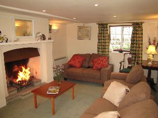 The sitting room has an open fire and fine views