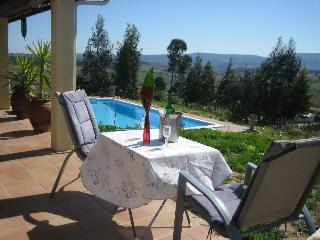 Sitting table outdoors with an amazing view of the outdoor swimming pool