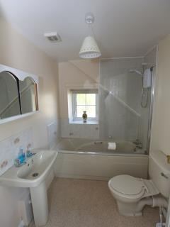 Upstairs bathroom to include an electric shower over bath