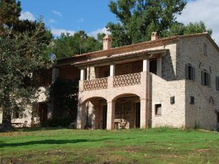 Il Casale, seen from lawn. Shaded balcony and portico on traditional Umbrian outside stair.