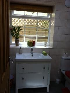 Bathroom bath, power shower, WC and heated towel rail