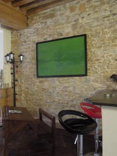 Breakfast bar and school desk, original stone walls