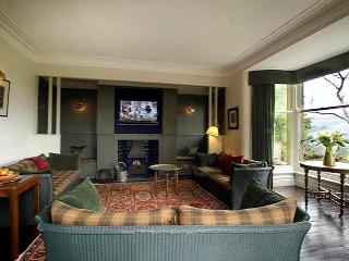 "Views across the Ribble valley, an inglenook fireplace and a 42"" plasma TV behind the paneling."
