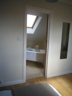 View to ensuite bath and shower room