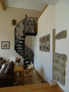 Spiral staircase to twin bed balcony bedroom