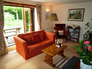 The sitting room has tri-fold doors to a large enclosed private garden