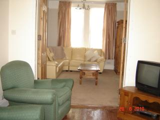Middle sitting room looking into front sitting room