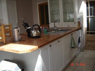 Kitchen with washing machine and island unit