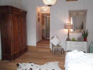 The main bedroom leading to contemporary en suite facilities.