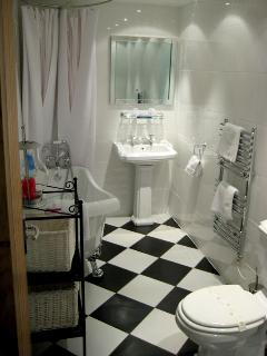 Family bathroom with roll top claw foot bath and rain shower