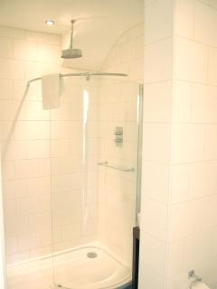 En-suite shower room with walk in rain shower