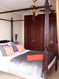 Master bedroom with doors directly out onto the patio
