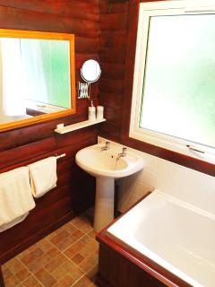 Bathroom with bath, electric shower & super-soft hotel quality towels.
