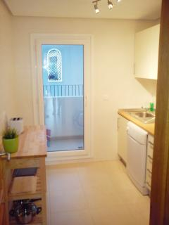 Fully equipped kitchen with door to utility area