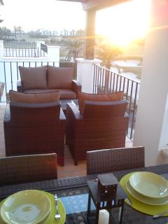 Half open and half shaded seating and dining area on the balcony