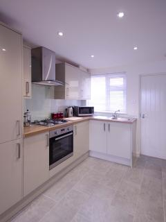 Brand new fitted kitchen with integrated washing machine and fridge freezer