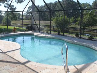 Newly re-modelled pool and paved lanai overlooking canal