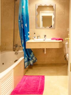 Our spacious main bathroom is adjacent to the master bedroom.