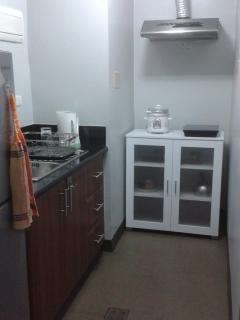 Kitchen with Electric Kettle. Rice Cooker. 1 induction cooker and refrigerator, toaster