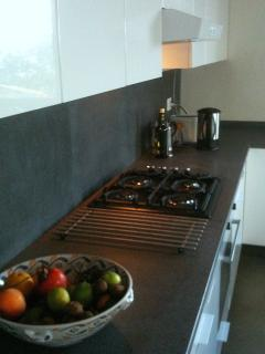 Beautiful and functional kitchen with lava stone worktop