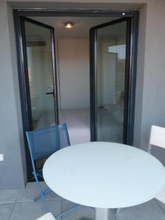 Terrace with doors leading through to the bedroom
