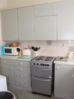 Compact Kitchen - equipped with all essentials including cooker, washing machine, fridge and freezer