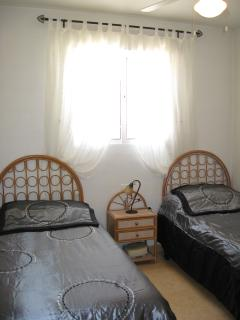 2nd Bedroom with twin beds and wardrobe