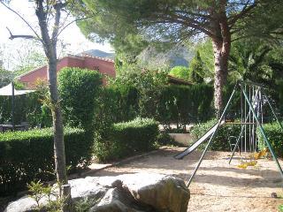 Children playground next to pool.