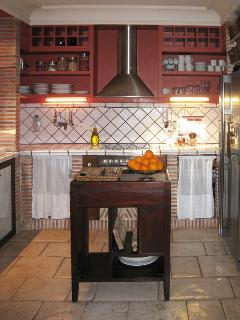 Rustic kitchen. Hob and oven.