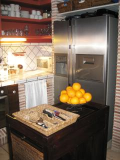 Kitchen. Refrigerator with ice and water dispenser. Microwave.
