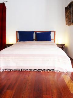 bedroom with wooden floor, ceilings, walk-in cubboard