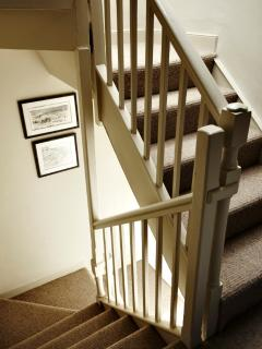 Staircase to first and second floor.