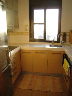 The modern kitchen is fully equipped with all the comforts of home, including a dishwasher.
