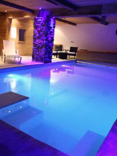Beautiful indoor swimming pool with mood lighting