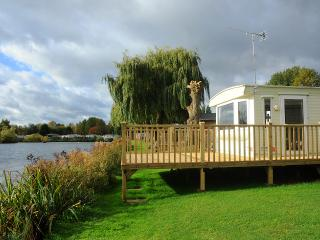 Front decking over looking lake ideal for fishing and BBQ's