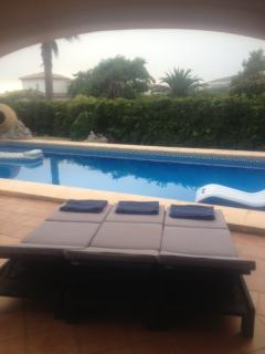 Veiw of poolside with new sunbeds from under neya