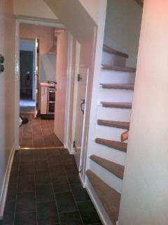 Hallway leading through to kitchen, rear porch and utility room with all facilities.