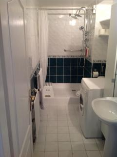 Master bathroom with washing machine for your laundry needs.